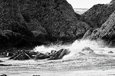 Photograph - waves breaking over downfaulted basalt rock layers part of the county antrim coastline at Ballintoy  by Joe Fox