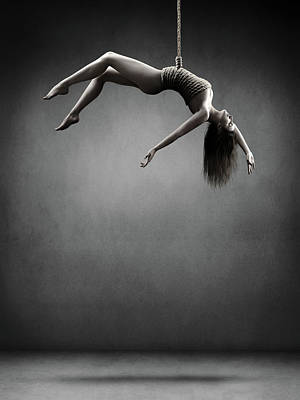 Surrealism Royalty-Free and Rights-Managed Images - Woman hanging on a rope by Johan Swanepoel