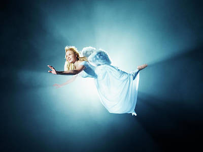 Photograph - Young Woman In Air, Low Angle View by Henrik Sorensen