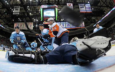 Scoring Photograph - Pittsburgh Penguins V New York Islanders by Bruce Bennett
