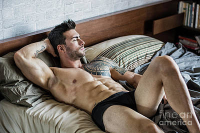 Superhero Ice Pops - Shirtless sexy male model lying alone on his bed by Stefano Cavoretto