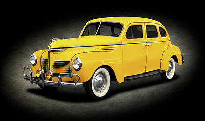 Photograph - 1940 Plymouth 4 Door Sedan  -  1940plymouth4doorsedanspttext186158 by Frank J Benz