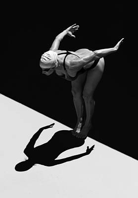 Photograph - A Woman Prepares To Jump Backwards Off by Ben Welsh