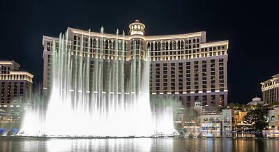 Photograph - Bellagio Resort Water Fountain Show At Night by Alex Grichenko