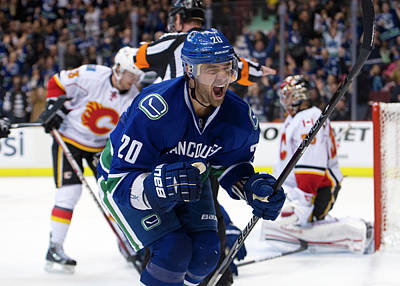 Photograph - Calgary Flames V Vancouver Canucks by Rich Lam