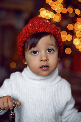 The Who - Child In A White Sweater And A Red Knitted Hat Stands by Elena Saulich