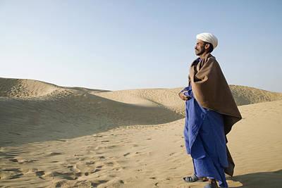 Photograph - Man Standing In A Desert, Thar Desert by Exotica.im