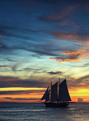 Photograph - Sailboat At Sunset by Thepalmer