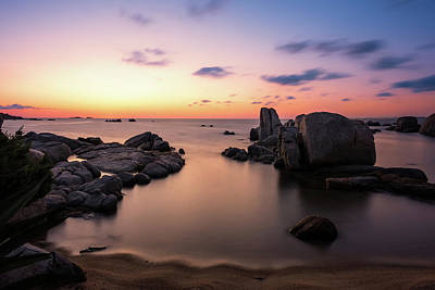 Nighttime Street Photography - Sunrise over boulders at Cavallo Island in Corsica by Jon Ingall