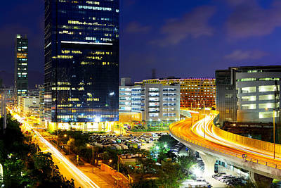 Financial District Photograph - City At Night With Traffic Trails by Ngkaki