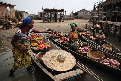Photograph - Daily Life In And Around Cotonou by Dan Kitwood