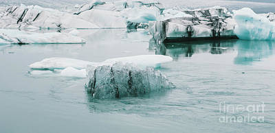 Brian Kesinger Steam Punk Illustrations Royalty Free Images - Huge blocks of ice on Glacial river and blue icebergs on Jokulsarlon glacier lake. Vatnajokull National Park, Iceland. Royalty-Free Image by Joaquin Corbalan