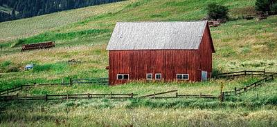 Photograph - landscape with a red barn in rural Montana and Rocky Mountains by Alex Grichenko