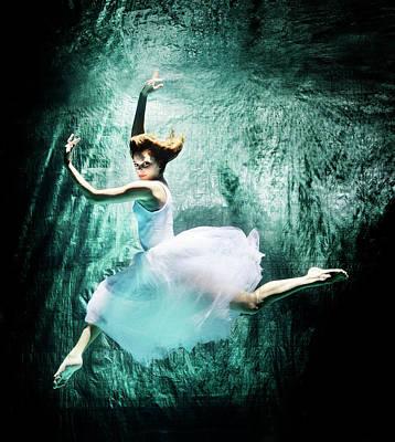 Photograph - Female Dancer Performing Under Water by Henrik Sorensen