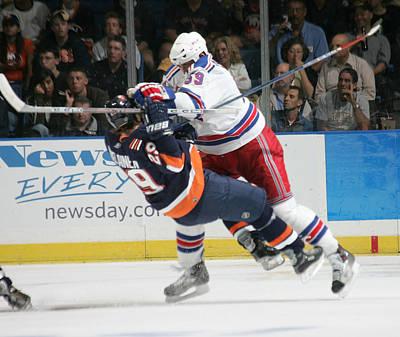 Photograph - New York Rangers V New York Islanders by Bruce Bennett