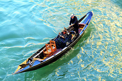 Photograph - A Boat Ride Through Venice by John Rizzuto