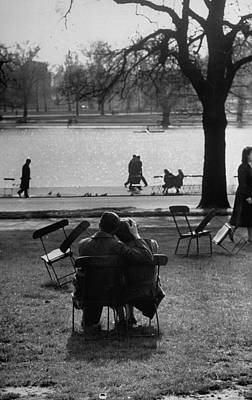 Hyde Park Wall Art - Photograph - A Couple Holding Each Other In Hyde Park by Cornell Capa
