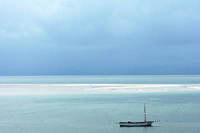 Dhow Photograph - A Fishing Dhow Anchored Of The Coast Of by Oliver Strewe