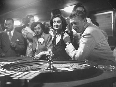 Photograph - A Group Of People Gambling At A Roulette by Gordon Parks