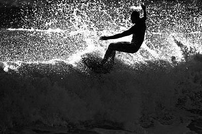 Photograph - A Male Surfer Does A Floater Over A by Kyle Sparks