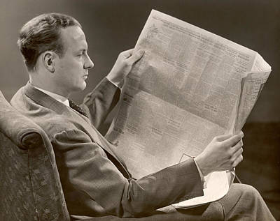 A Man Reads A Newspaper Art Print by George Marks