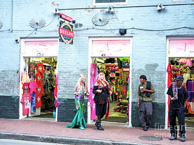 Photograph - A Mermaid And Pirate On Bourbon Street In New Orleans by John Rizzuto