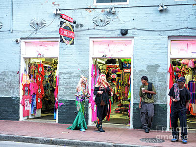Photograph - A Mermaid And Pirate On Bourbon Street New Orleans by John Rizzuto