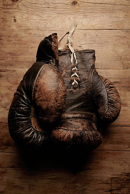 A Pair Of Worn Old Boxing Gloves On Art Print by The flying dutchman