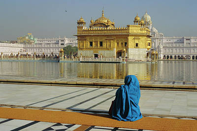 Indian Culture Photograph - A Pilgrim In Blue Sits By The Holy Pool by Jeremy Bright / Robertharding