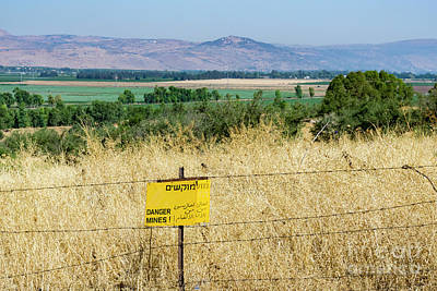 Photograph - A Sign Warns Of Uncleared Mines In The Golan Heights, Israel. by William Kuta