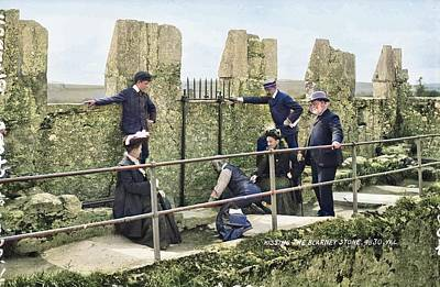 World War Two Production Posters - A small group of tourists seeking the alleged eloquence that comes from kissing the Blarney Stone at by Artistic Panda