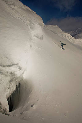 Photograph - A Snowboarder Surfing On Powder In The by Ryan Creary