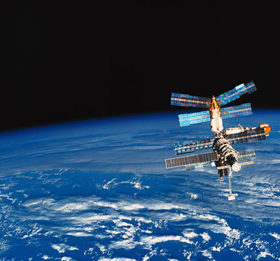 Photograph - A Space Station Orbiting Above Earth by Stockbyte