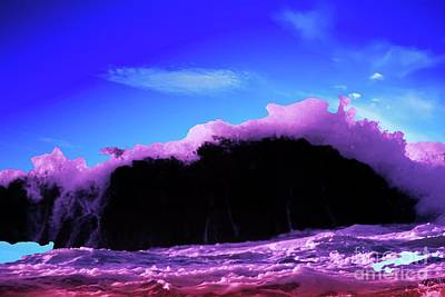 Royalty-Free and Rights-Managed Images - A wave overcoming a rock by Jeff Swan