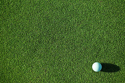 Photograph - A White Golf Ball On Pristine Green by Love life