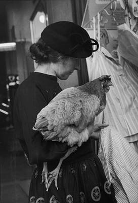 Photograph - A Woman & Her Chicken Go Shopping by Nina Leen