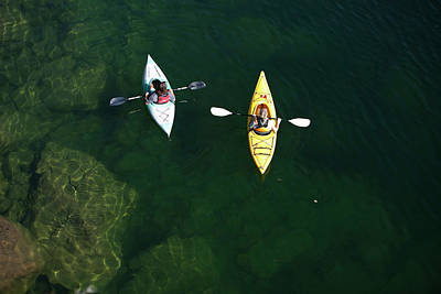 Photograph - A Young Adult Couple Kayaking On A by Patrick Orton