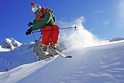 Ski Resort Photograph - A Young Skier, A Freerider Jumps Over A by Bernard Van Dierendonck / Look-foto