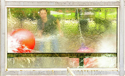 Fun Patterns - Abstract picture of a childs game in which a ball is flushed through a basket with a water pistol, shot from the back of a glass pane in the target area by Frank Heinz