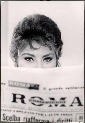 Italy Photograph - Actress Sophia Loren Impishly Peering by Alfred Eisenstaedt