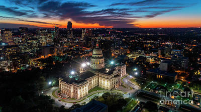Photograph - Aerial image of vibrant orange and soft blues in a dramatic sky  by Austin Bat Tours