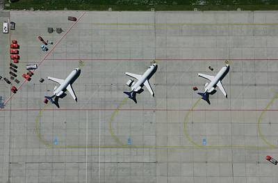 Photograph - Aerial View Of A Row Of Airplanes Parked by Stephan Zirwes