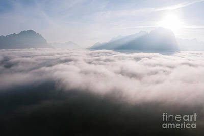 Photograph - Aerial View Of Low Clouds And Mountain Peak At Sunrise by Matteo Colombo