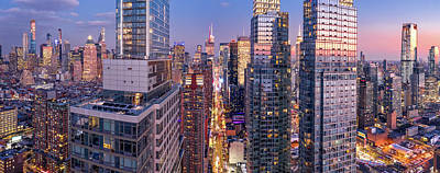 Skylines Royalty-Free and Rights-Managed Images - Aerial view of New York City skyscrapers at dusk by Mihai Andritoiu