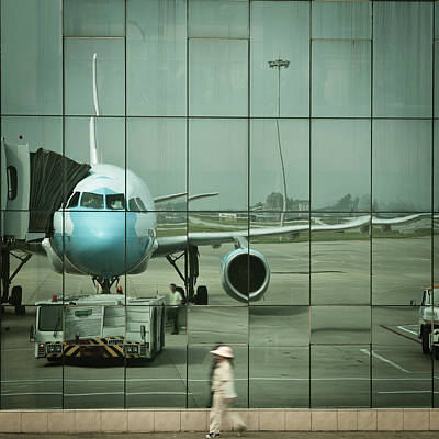 Photograph - Airport Reflections by Capturing A Second In Life, Copyright Leonardo Correa Luna
