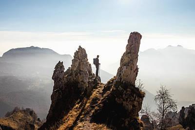 Photograph - Alpinist Admires The Mountain Landscape by Deimagine