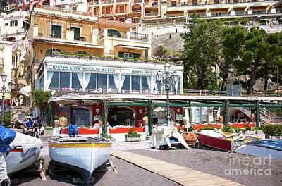 Photograph - Amalfi Coast Beach Dining In Positano by John Rizzuto