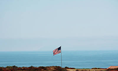 Tranquility Photograph - American Flag Along The Coast Of by Amanda Bolland