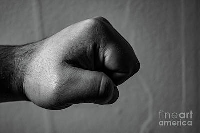 Red Roses - An aggressive monochrome adult male clenched fist isolated on a black background. by Kaleb Kroetsch