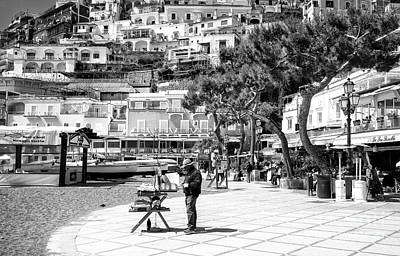 Photograph - An Artist Paints In Positano by John Rizzuto